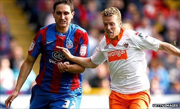 Aleksandar Tunchev (left) and Blackpool's Billy Clarke