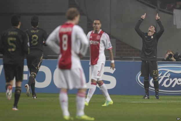 Jose Callejon (right) scores for Real Madrid against Ajax