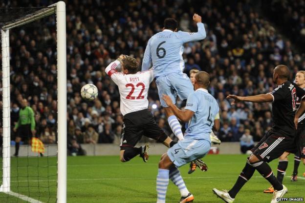 Joleon Lescott challenges the Bayern Munich goalkeeper Hans Jorg Butt
