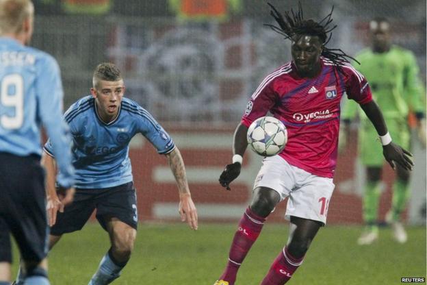 Bafetimbi Gomis (right) of Lyon scores the fastest Champions League hat-trick