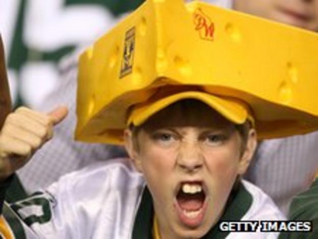 """Green Bay Packers fan wearing """"cheesehead"""" hat"""