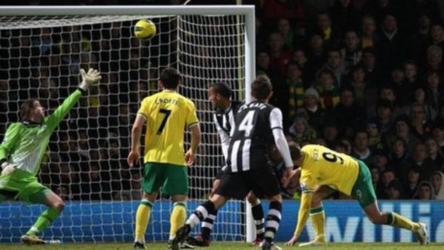Norwich striker Grant Holt scores the fourth