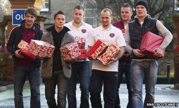 Hearts players (from left) Rudi Skacel, Ian Black, Danny Grainger, Jamie Hamill, Marian Kello and Marius Zaliukas arrive at the Royal Hospital for Sick Children to give presents to kids