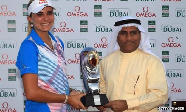 Lexi Thompson receives the Dubai Ladies Masters trophy