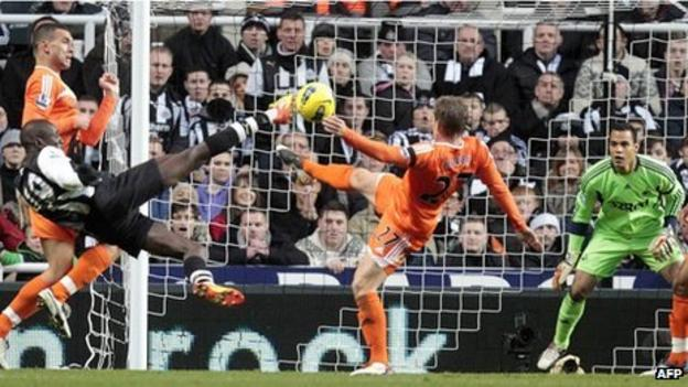 Demba Ba fires an acrobatic volley at Swansea's goal