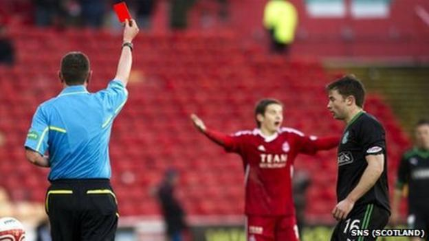 Referee Craig Thomson shows Peter Pawlett the red card