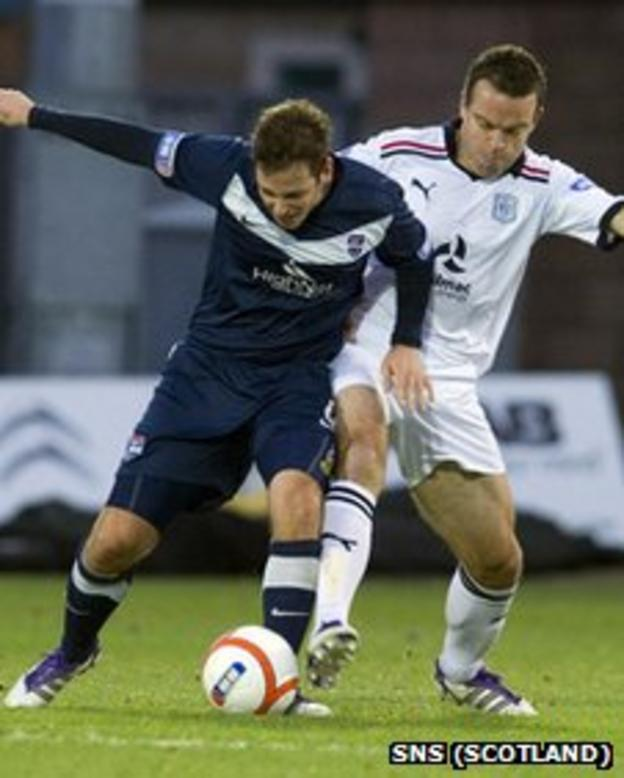 Paul Lawson and Gavin Rae battle for possession
