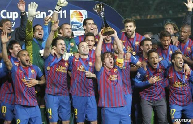 Carles Puyol (centre) lifts the trophy