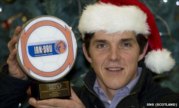 Ian Little with his award