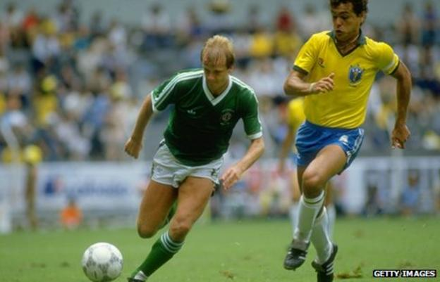 Colin Clarke battles with Brazil's Edhino during the 1986 World Cup finals