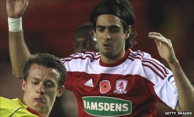 Rhys Williams tussles with a Watford player