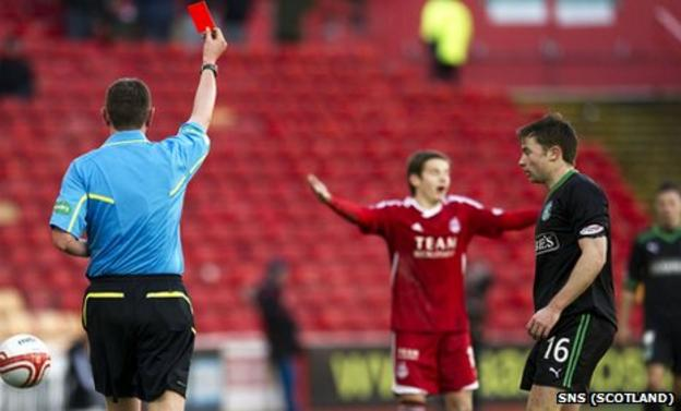 Referee Craig Thomson shows Peter Pawlett a red card