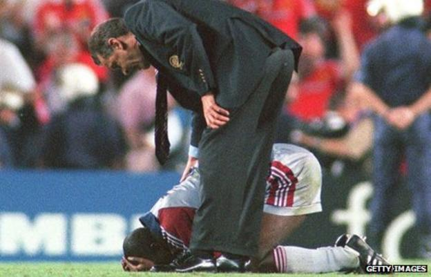 Samuel Kuffour is comforted after Manchester United's dramatic win in the final of the European Champions League in 1999