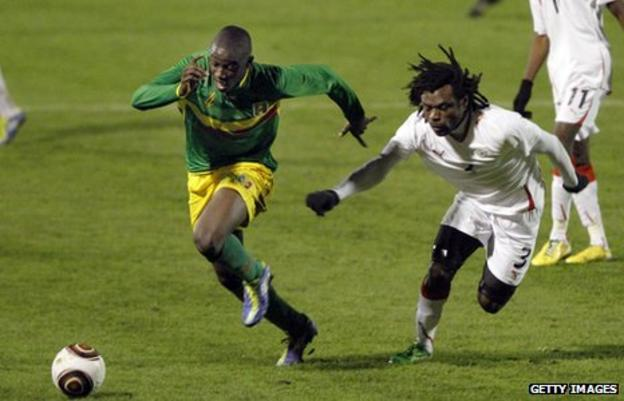 Mali's Cedric Kante (left) in action with Burkina Faso's Herve Zengue