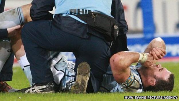 Jamie Roberts receives treatment before going off