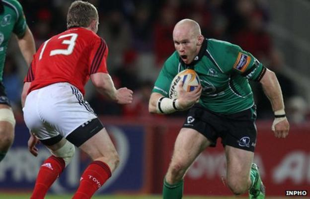 Munster's Keith Earls moves in to challenge Connacht's Johnny O'Connor