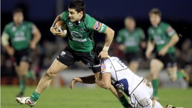 Connacht wing Tiernan O'Halloran is tackled by Isa Nacewa