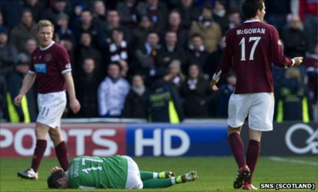 Ivan Sproule is grounded after an altercation with Ryan McGowan