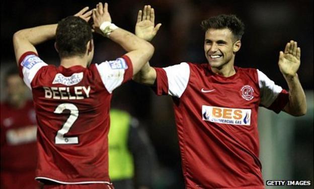 Fleetwood players celebrate beating Yeovil