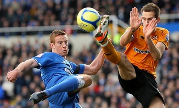 Roger Johnson challenges for the ball with Adam Rooney