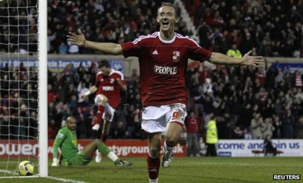 Swindon's Paul Benson celebrates the goal which knocked Wigan out of the FA Cup