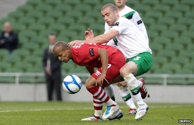 Wales striker Robert Earnshaw battles with Northern Ireland's Colin Coates last May