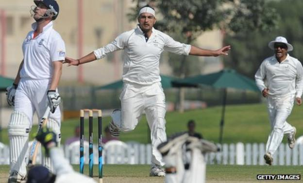 Afghanistan paceman Hamid Hassan celebrates after having Jonathan Trott (left0 caught behind