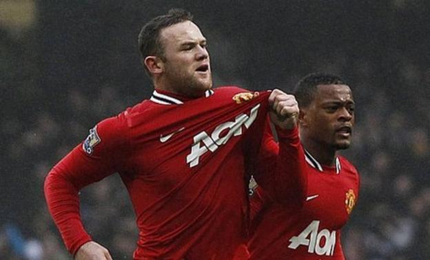 Wayne Rooney celebrates his first goal at the Etihad