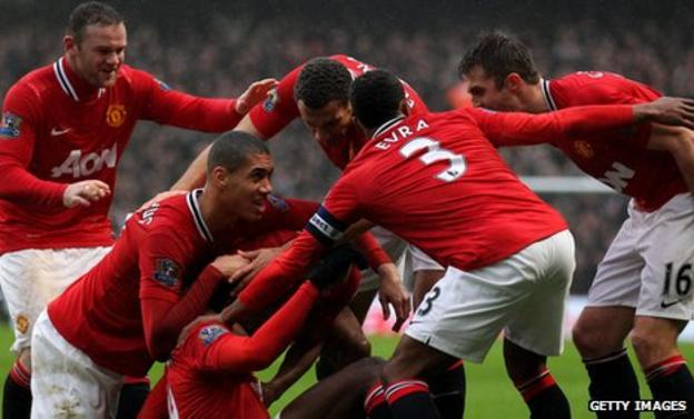 Manchester United celebrate their 3-2 win over Manchester City in the FA Cup third round