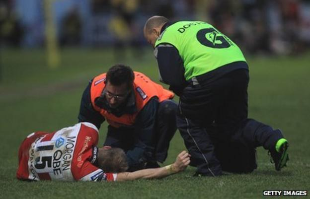 Olly Morgan receives treatment for an injury