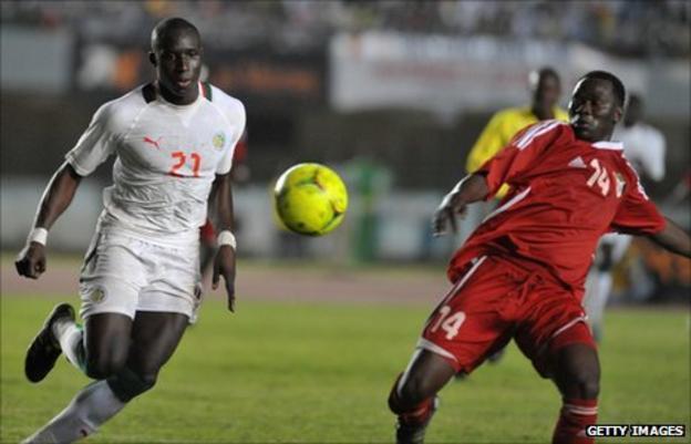Senegal's Mohamed Diane (left)