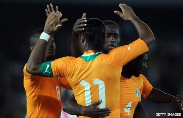 Didier Drogba (number 11) celebrates with fellow goalscorer Salomon Kalou (left)