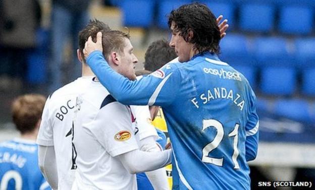 Francisco Sandaza shares an embrace with Rangers captain Steven Davis