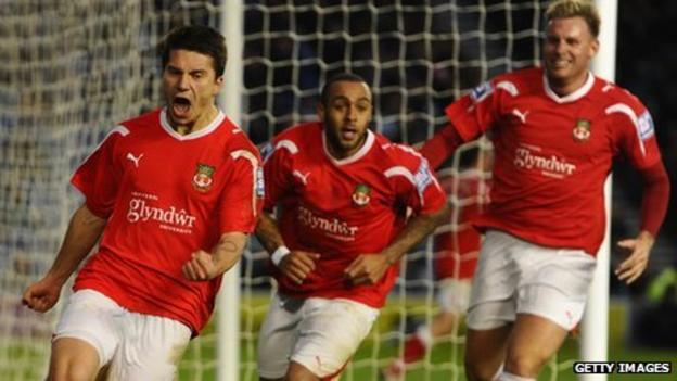 Cieslewicz (left) celebrates after scoring Wrexham's equaliser at Brighton