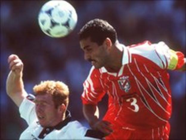 Tunisia's Sami Trabelsi (right) in action against Paul Scholes of England
