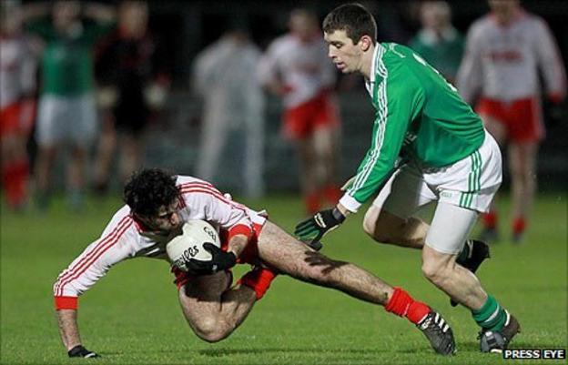 Tyrone's Jonathan Lafferty in possession against Barry Owens of Fermanagh