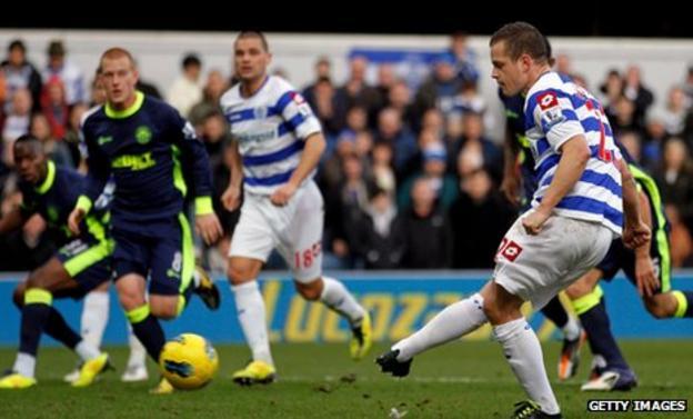 QPR striker Heidar Helguson opens the scoring against Wigan