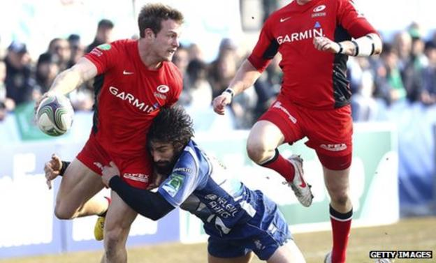 Saracens wing James Short pass the ball out of a tackle by Ludovico Nitoglia