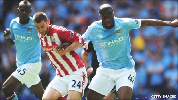 Stoke City's Rory Delap challenges Manchester City's Yaya Toure in the 2011 FA Cup final at Wembley
