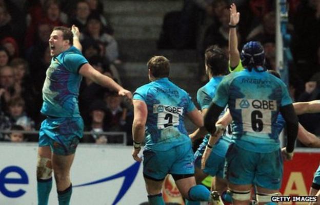 Brett Sturgess celebrates his try against Perpignan