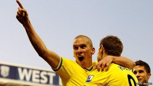 Steve Morison celebrates his winning goal for Norwich City at West Brom with Grant Holt
