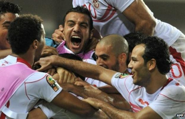 Tunisian players celebrate their victory over Morocco