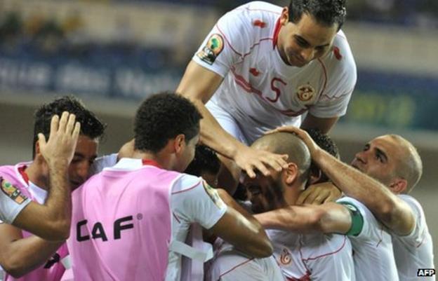 Tunisia players celebrate their 2-1 win over Morocco