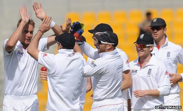England celebrate a wicket by Stuart Broad (far left)
