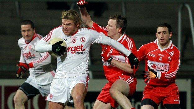 Owen Mulligan is challenged by Derry's Brian McCallion in this year's decider