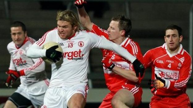 Owen Mulligan is challenged by Derry's Brian McCallion in the decider