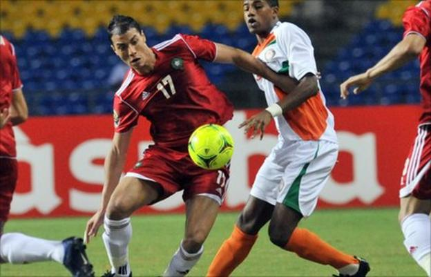 Marouane Chamakh (in red)
