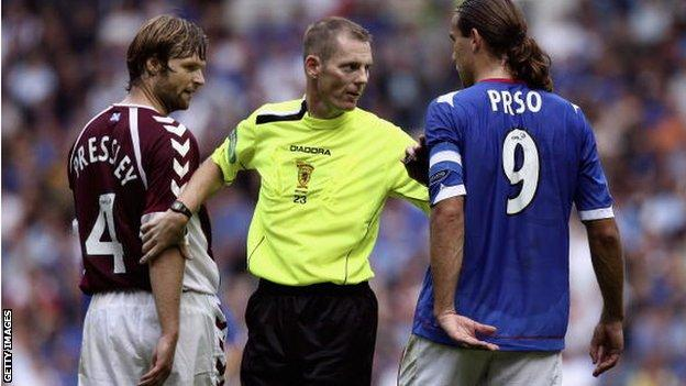 Referee Kenny Clark taking charge at a Scottish game between Rangers and Hearts