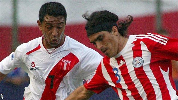 Nolberto Solano and Claudio Morel