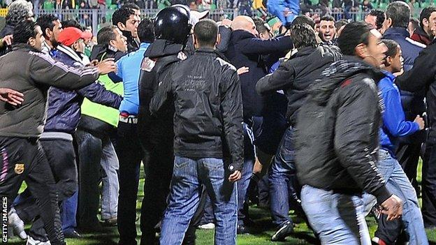 Fans clash after the match between Al-Ahly and Al Masry